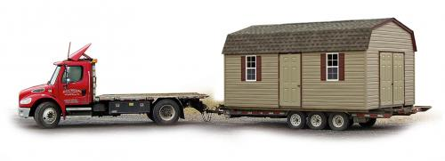 Pine Creek Structures Delivery Trick with Gambrel Barn Shed on trailer